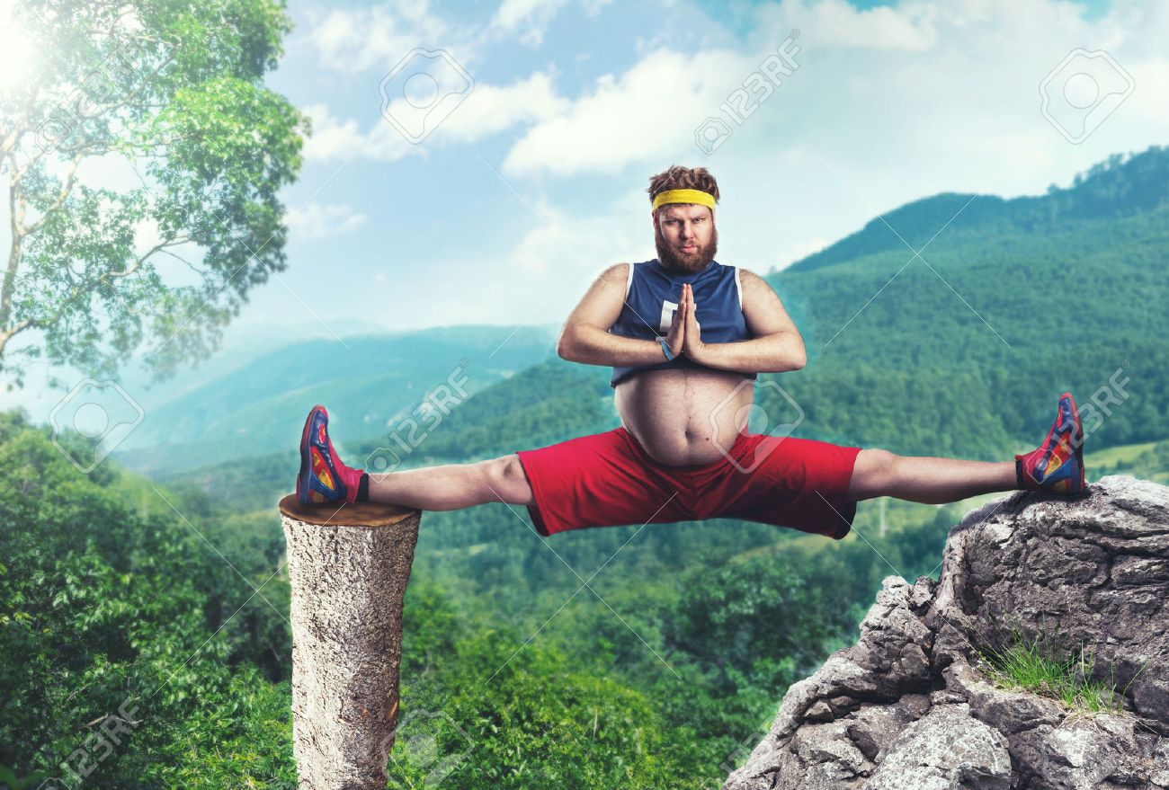 Fat sportsman does the splits in the mountains Stock Photo - 40119258