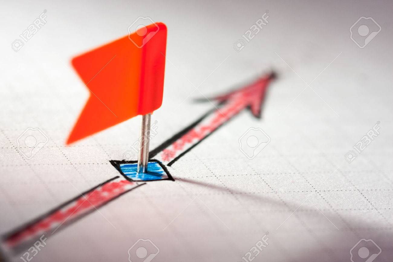 A pin on sketched red arrow on the paper Stock Photo - 40893576