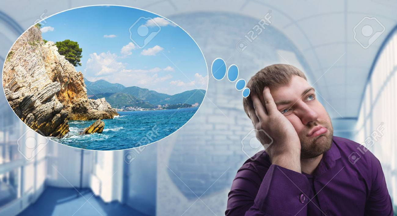 Sad man dreaming about his summer vacation at work Stock Photo - 43775972