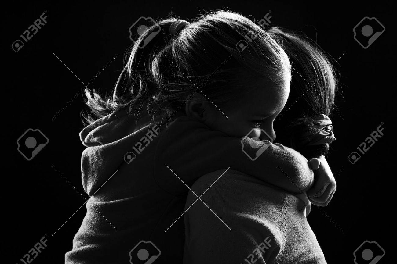 Black and white image of a little girl hugging her mother Stock Photo - 44113713