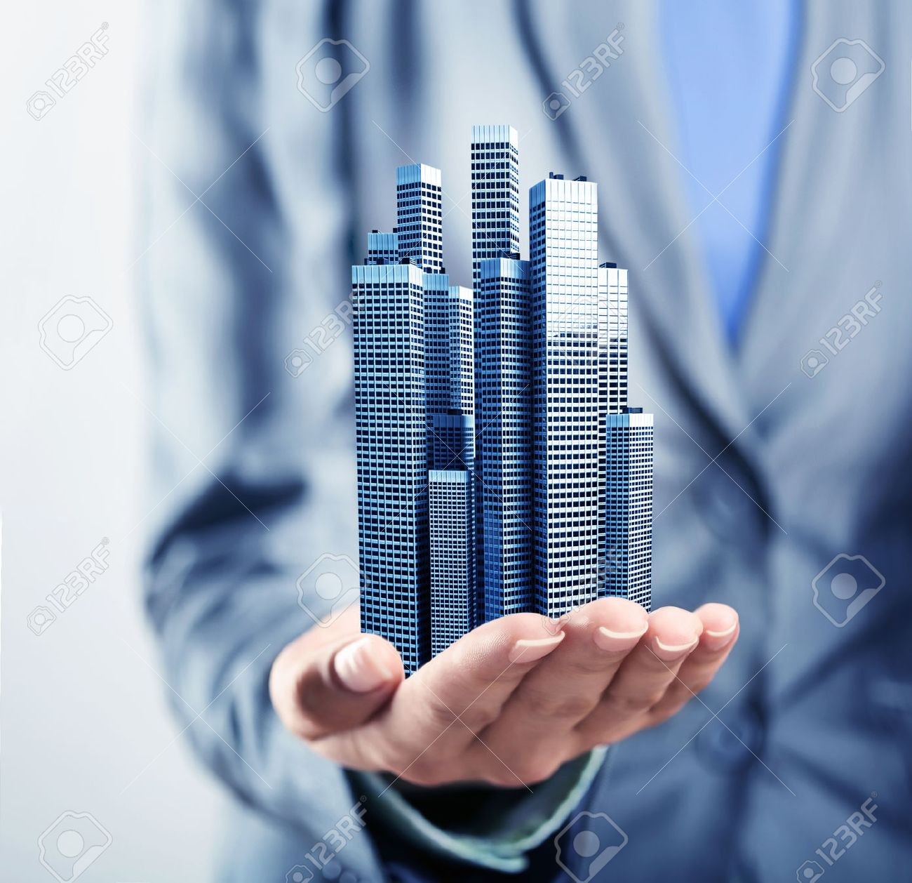 Office buildings standing on the human palm Stock Photo - 45584500