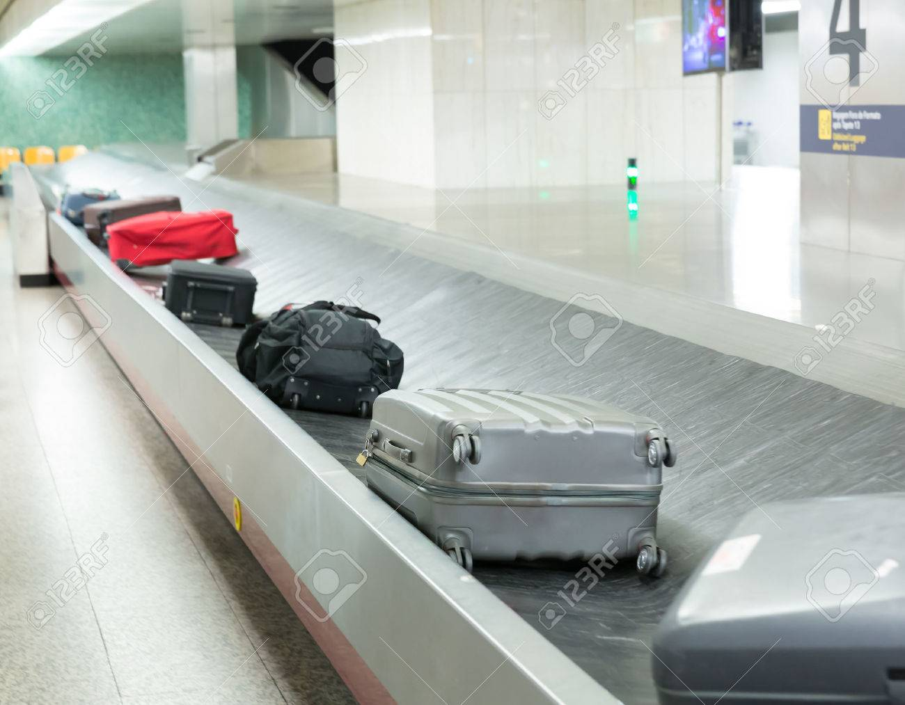 Luggage on the belt in the airport closeup Stock Photo - 45947490