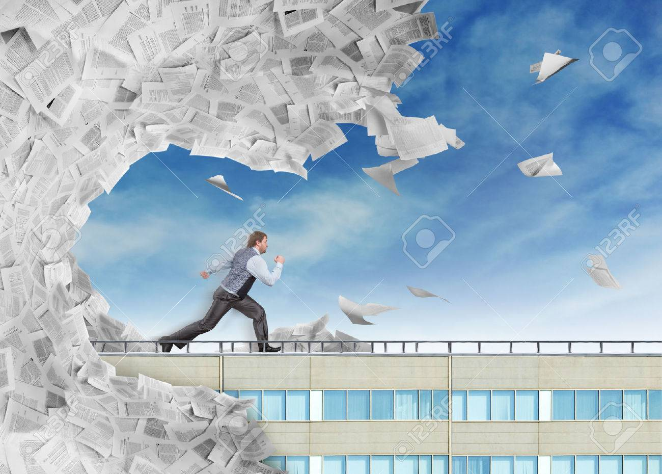 Businessman is running from big wave of paperwork Stock Photo - 47187967