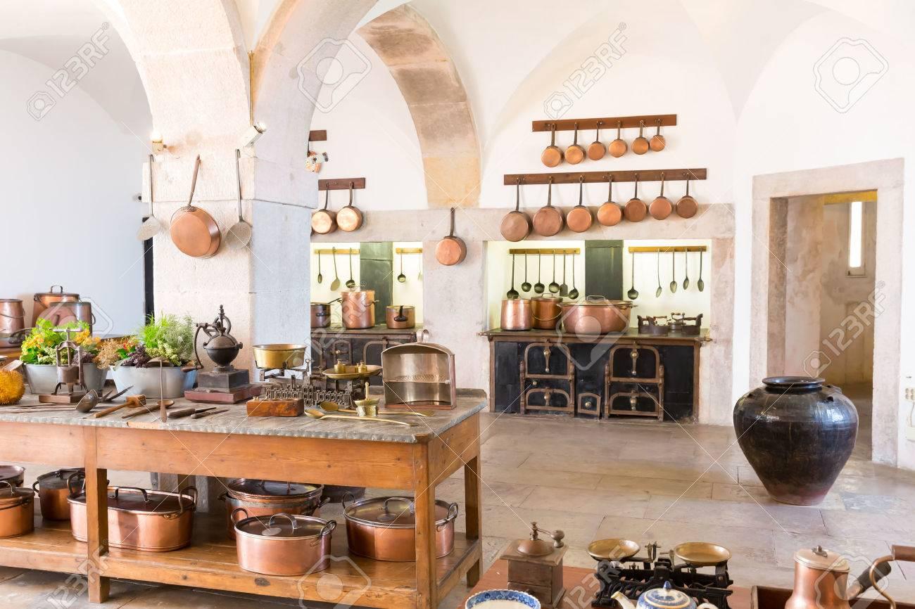 Retro kitchen interior with old brass kitchenware - 48176030