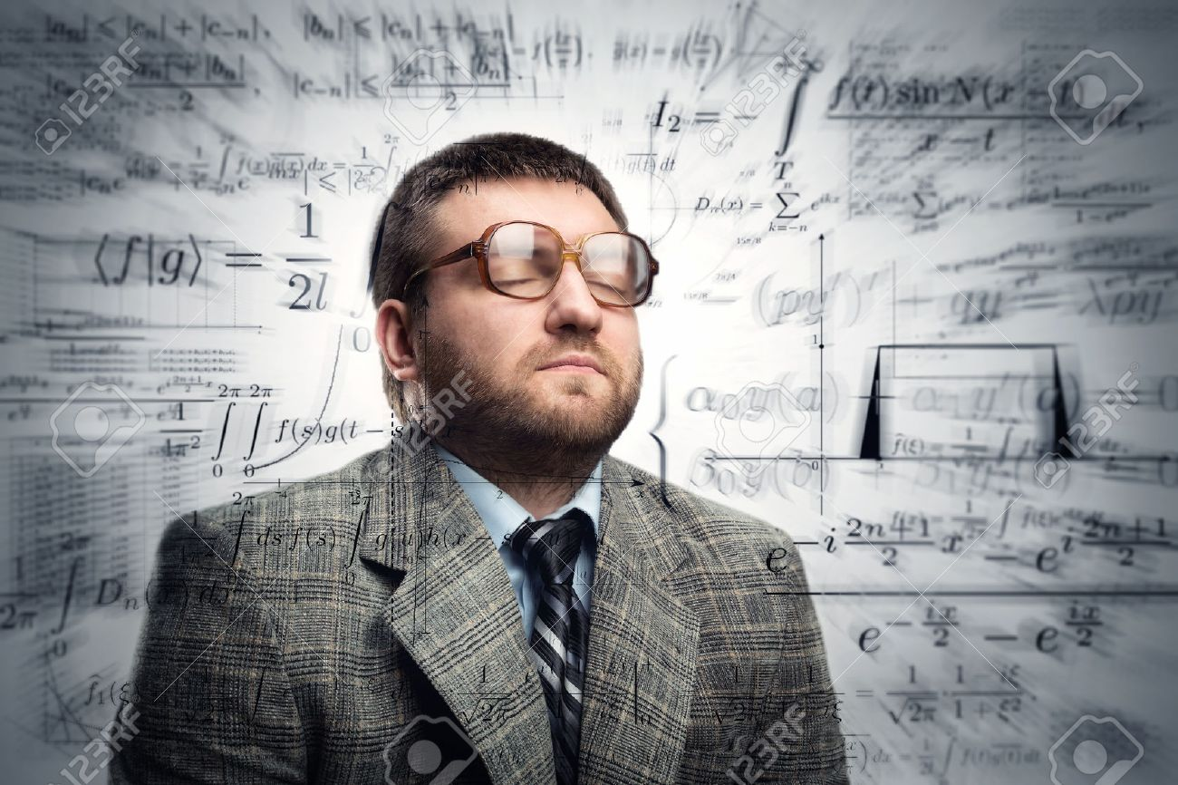 Professor in glasses thinking about math formulas Stock Photo - 49820654