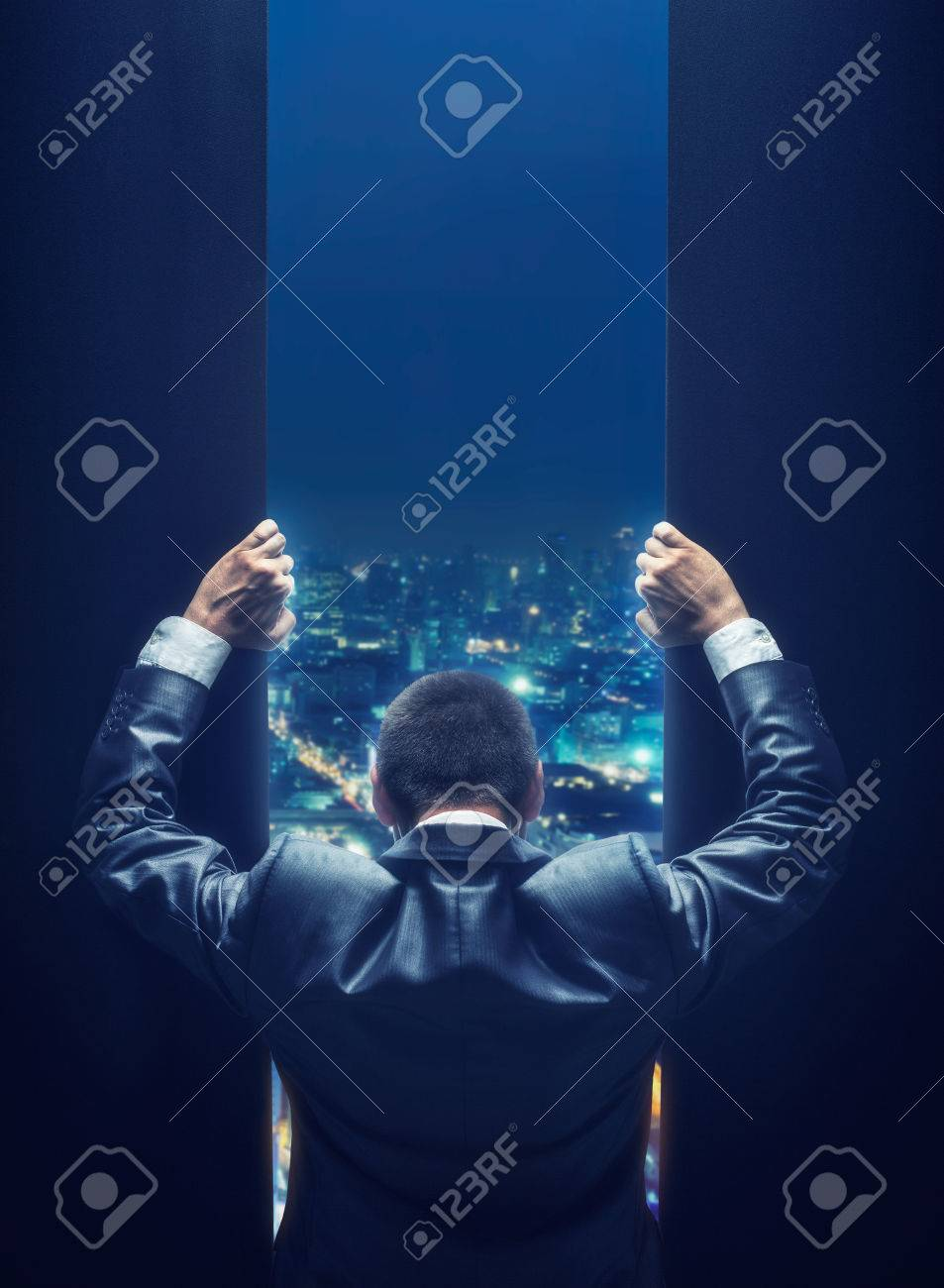 Businessman opening the gate to a night cityscape - 49820910