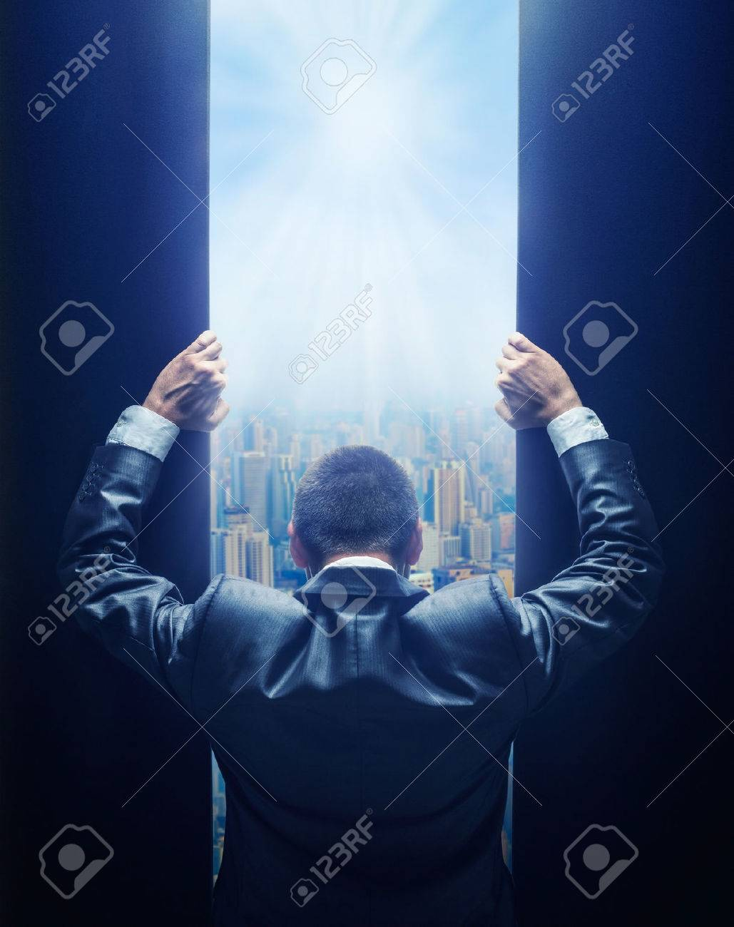 Businessman opening the gate to the city - 50840612