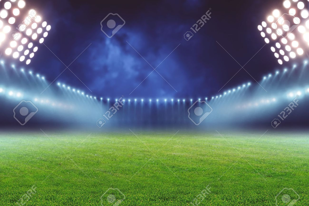 View of emty illuminated football ground at night - 52254287