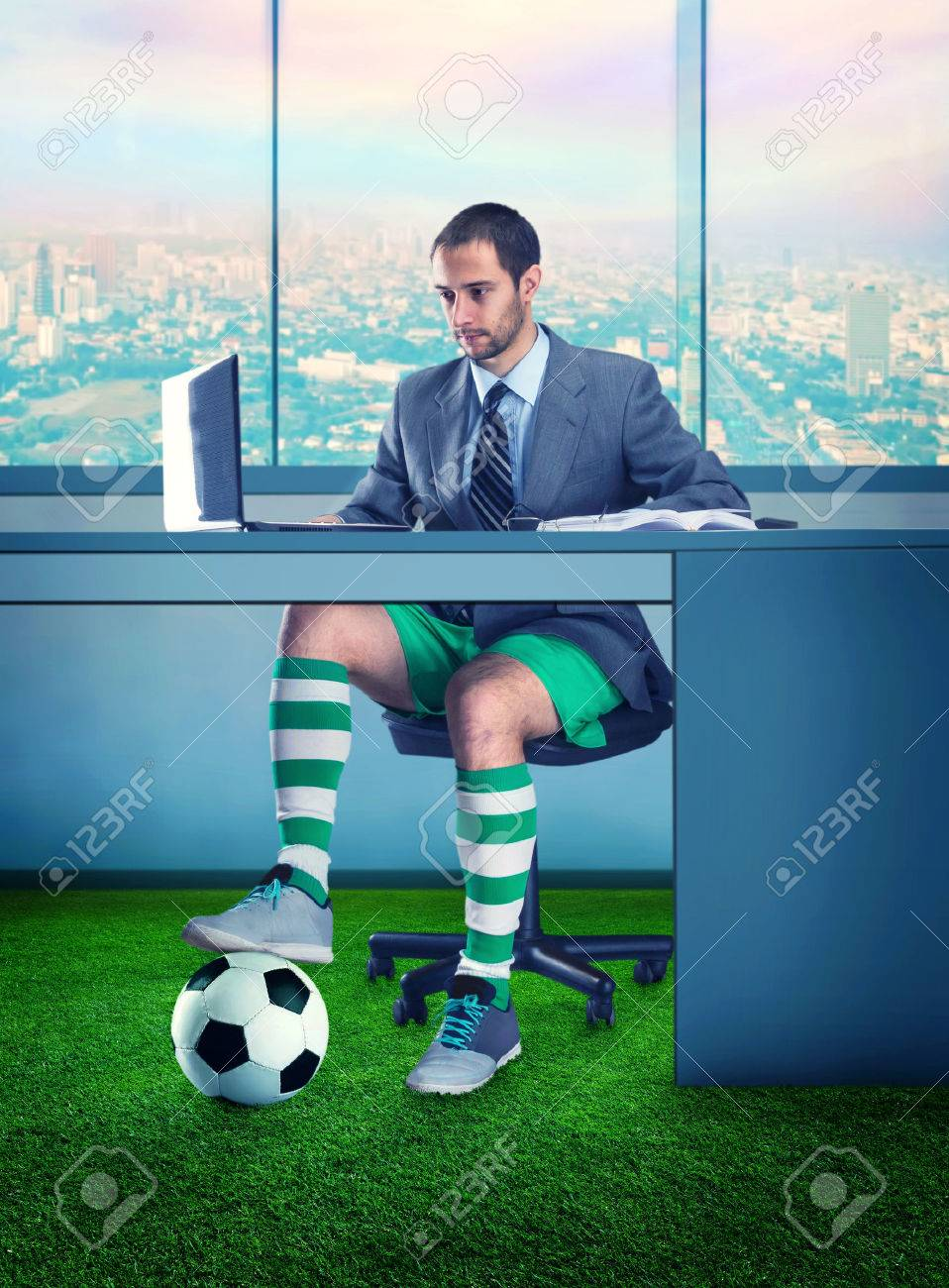 Businessman in shorts and with a ball under the table - 52827159
