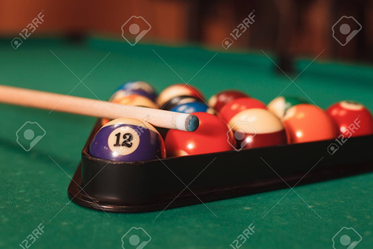 Billiard Balls In Triangle Near By Cue On The Pool Table Stock - Pool table near by