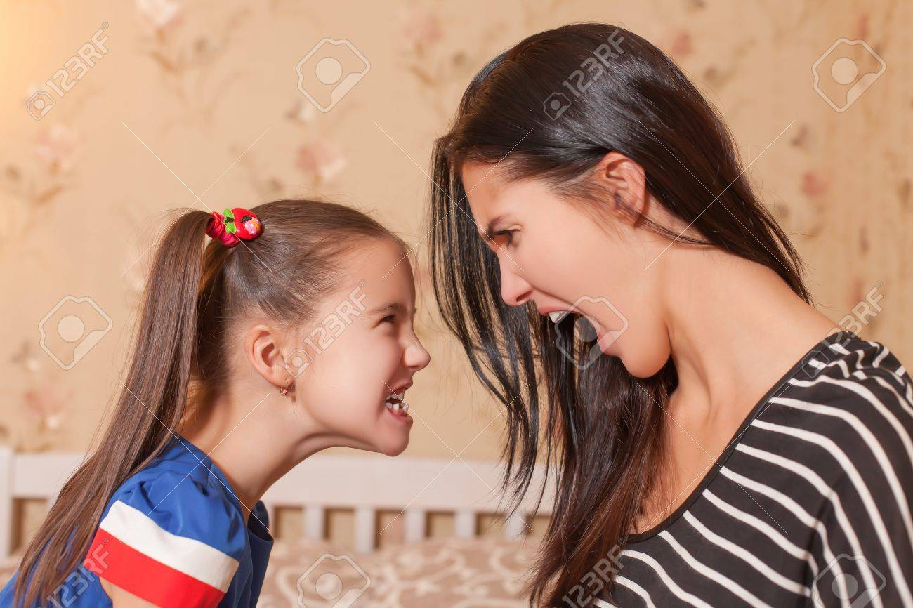 Young mother and her little daughter make each other terrible faces Stock Photo - 68507388