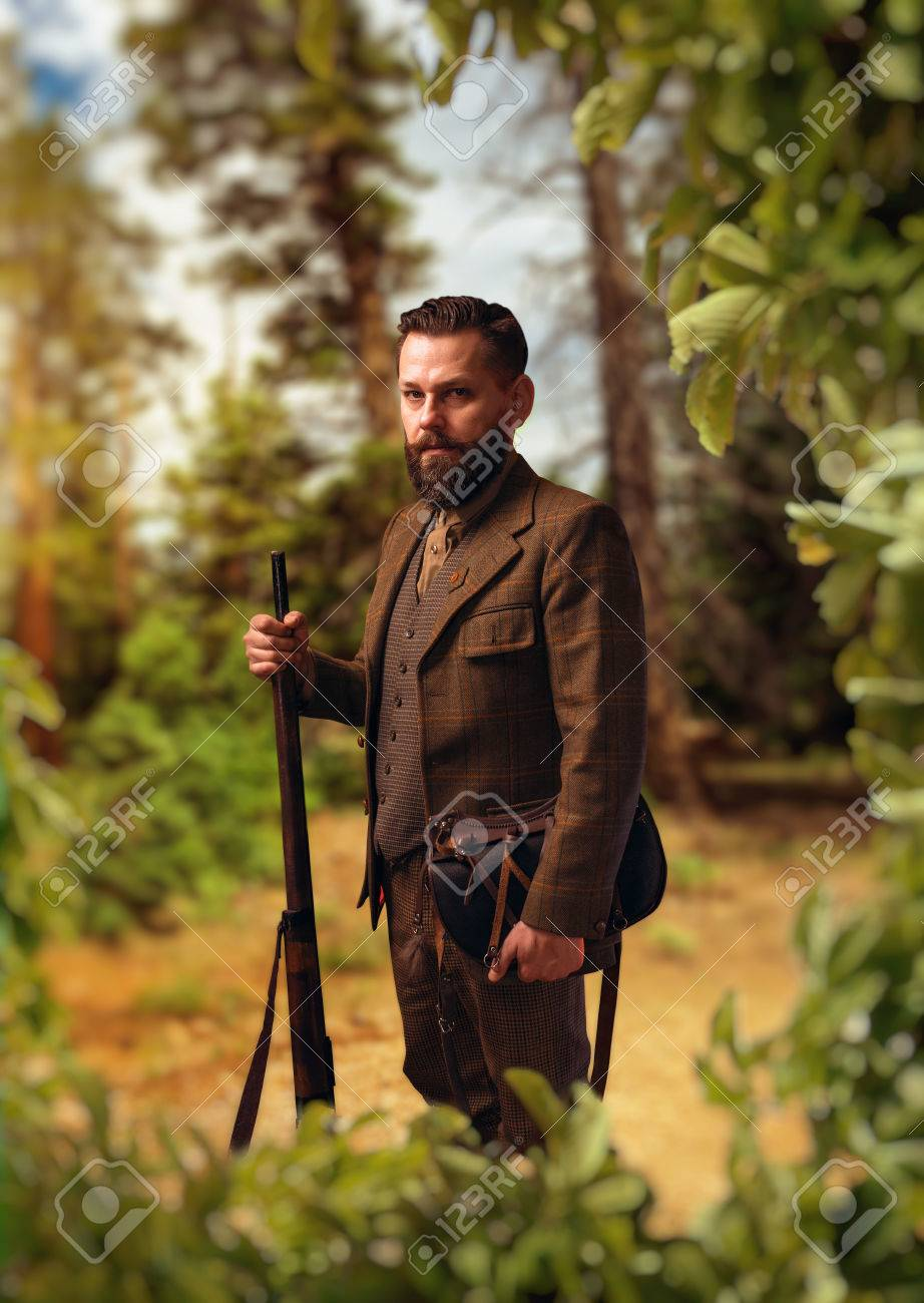 c43717b1bc41f Portrait of hunter in traditional hunting clothing Stock Photo - 74578225