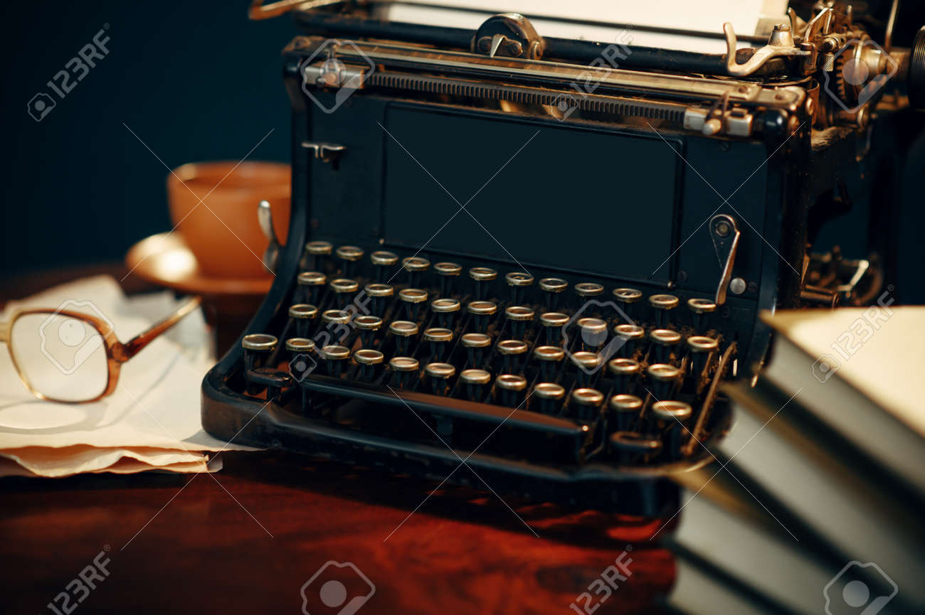 Vintage typewriter on wooden table in home office - 153025466