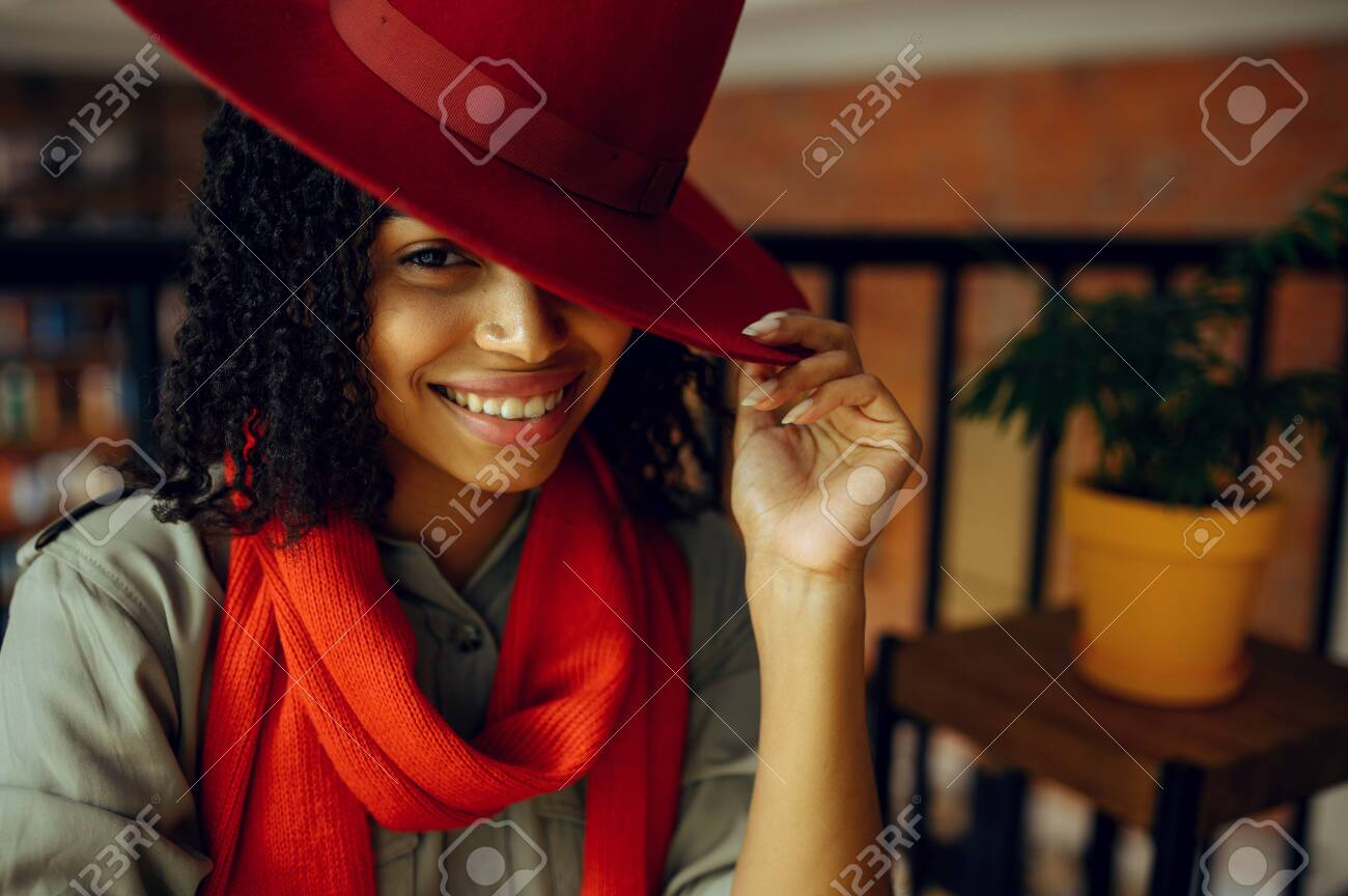 Pretty Female Student In Red Hat Poses In Cafe Stock Photo Picture And Royalty Free Image Image 153953705