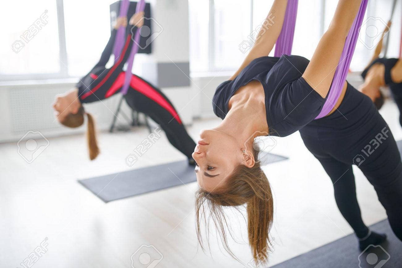 Aerial or aero yoga, group training on hammocks - 168923038