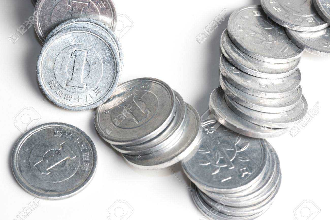 pile of 1 yen coins japanese money close up isolated on white