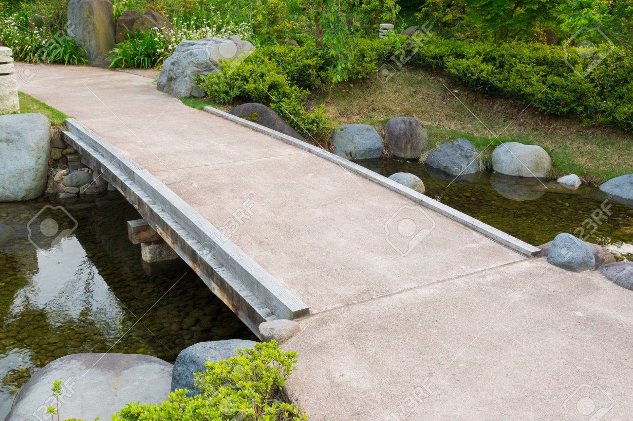Stone Path In A Japanese Garden Bridge Across Tranquil