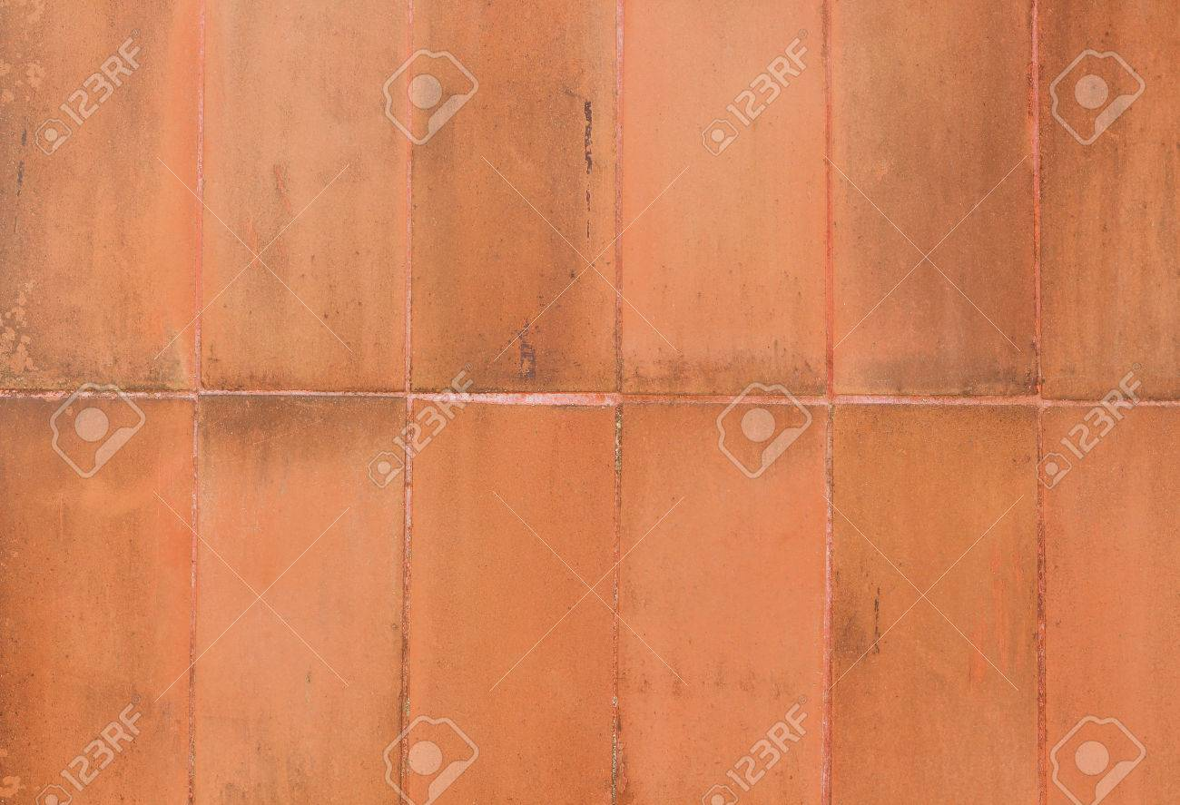 Terracotta wall square tile background texture stock photo