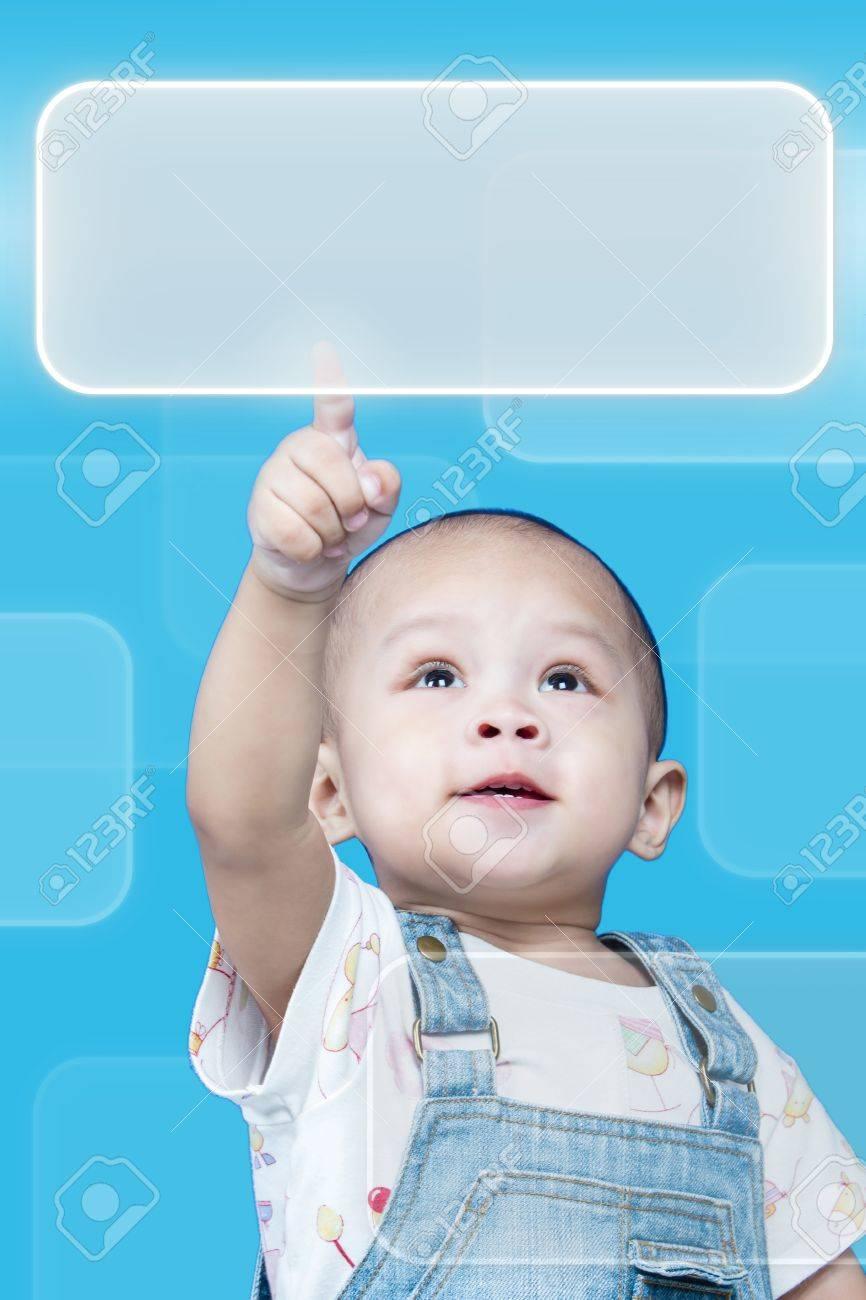Child raises up forefinger is push button Stock Photo - 17641810