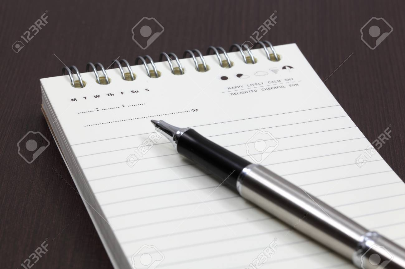Blank note paper with pen Stock Photo - 18357239