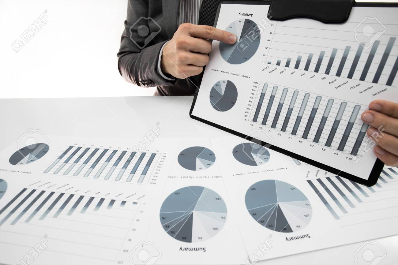 man hand with business report on table Stock Photo - 23456275