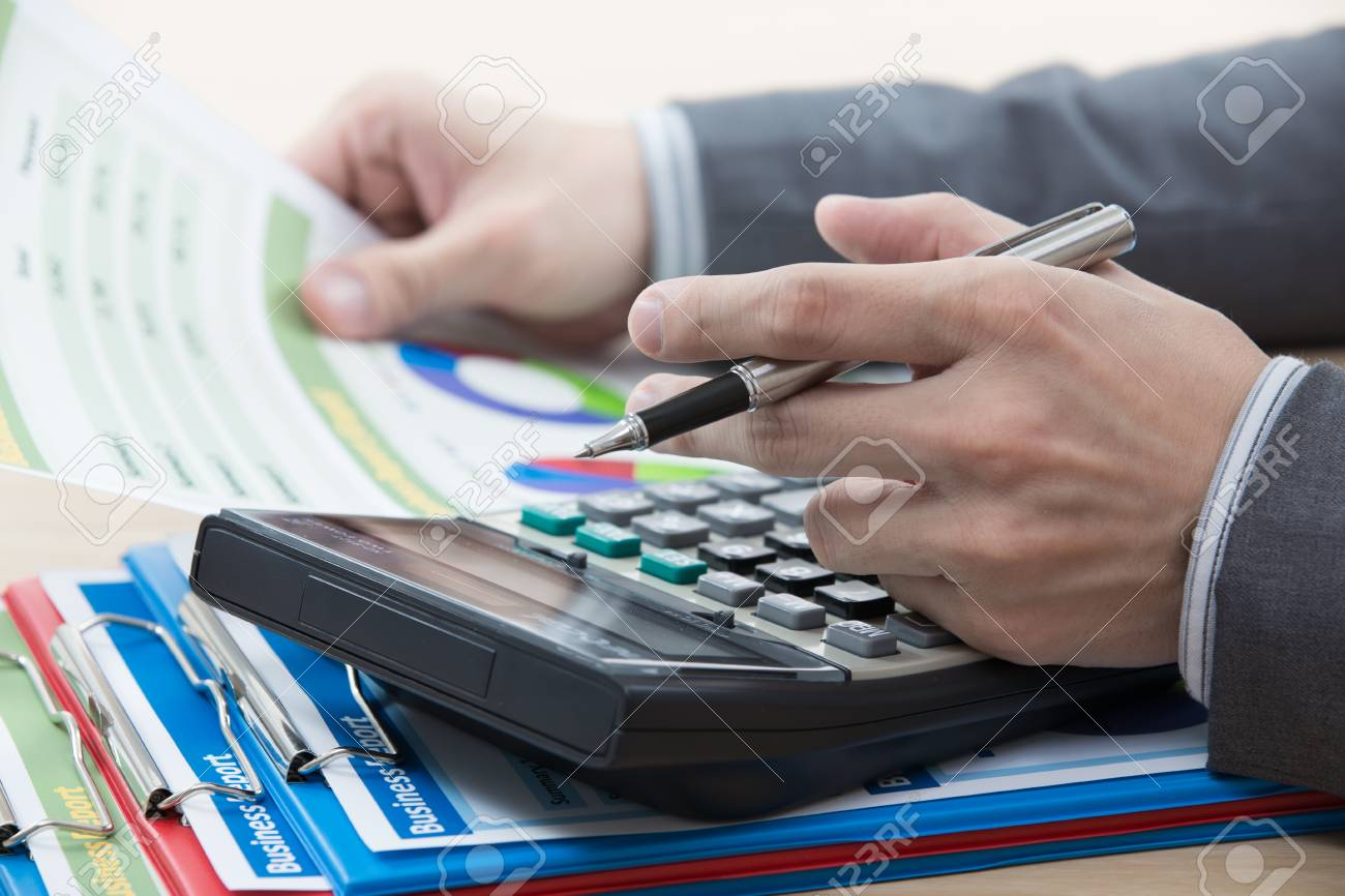 man hand with pen and business report Stock Photo - 24241002