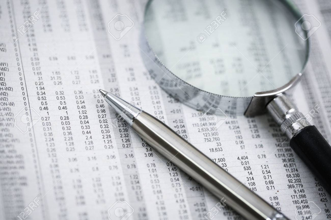Ballpoint pen resting on world currency figures.Accounting Stock Photo - 29116420