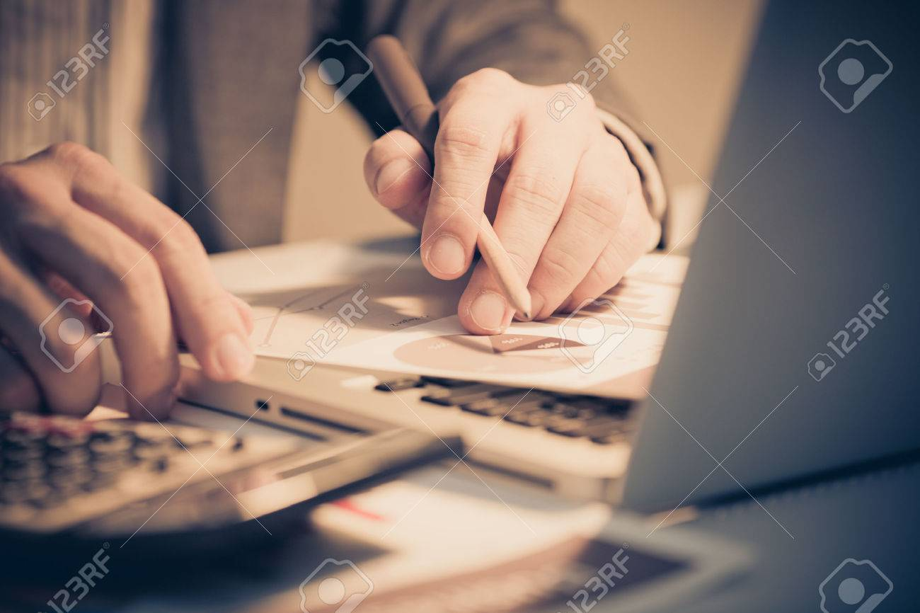 Businessman analyzing investment charts with laptop. Accounting Stock Photo - 30965103