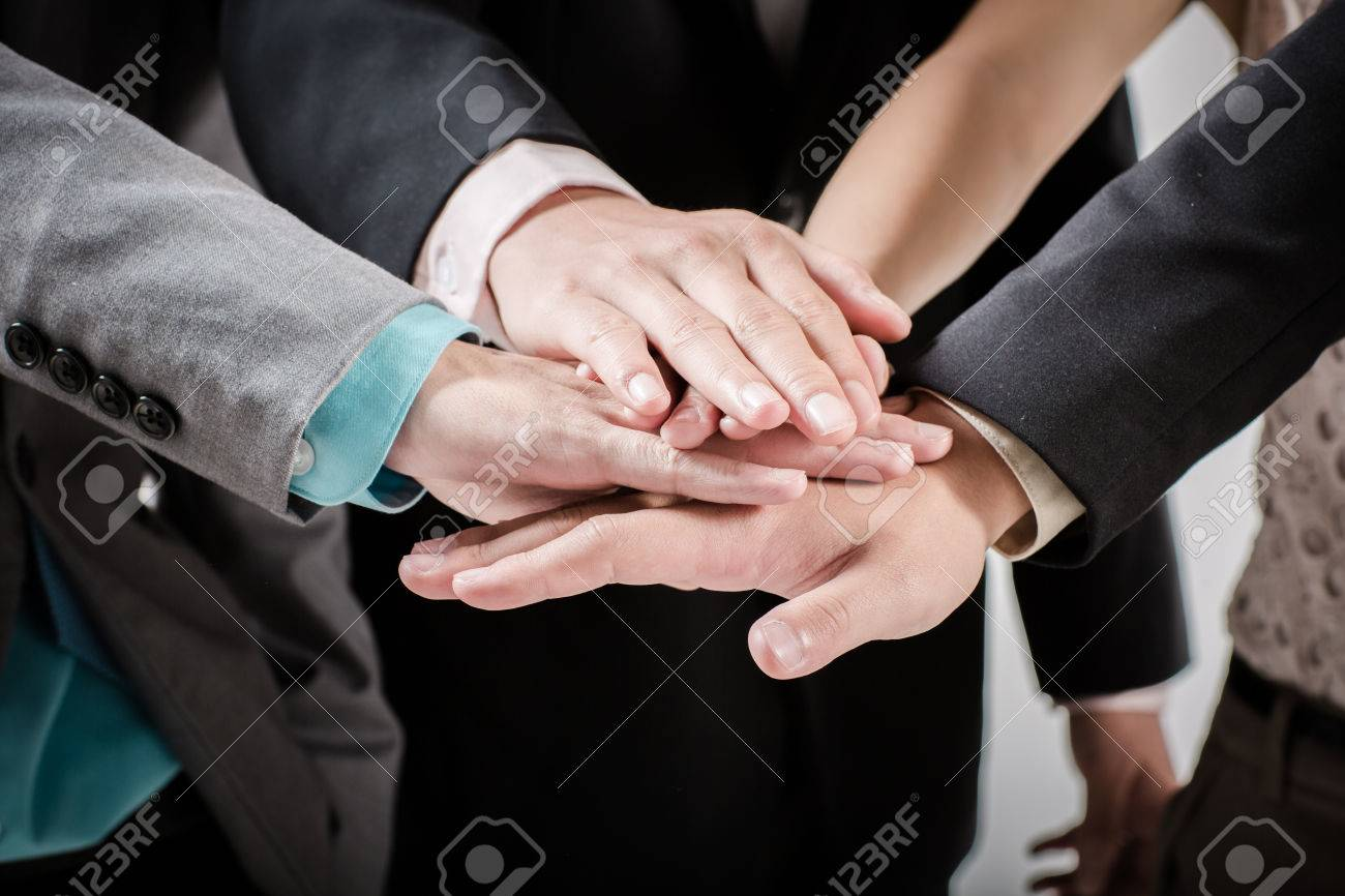 Business group with hands together - teamwork concepts Stock Photo - 30962515
