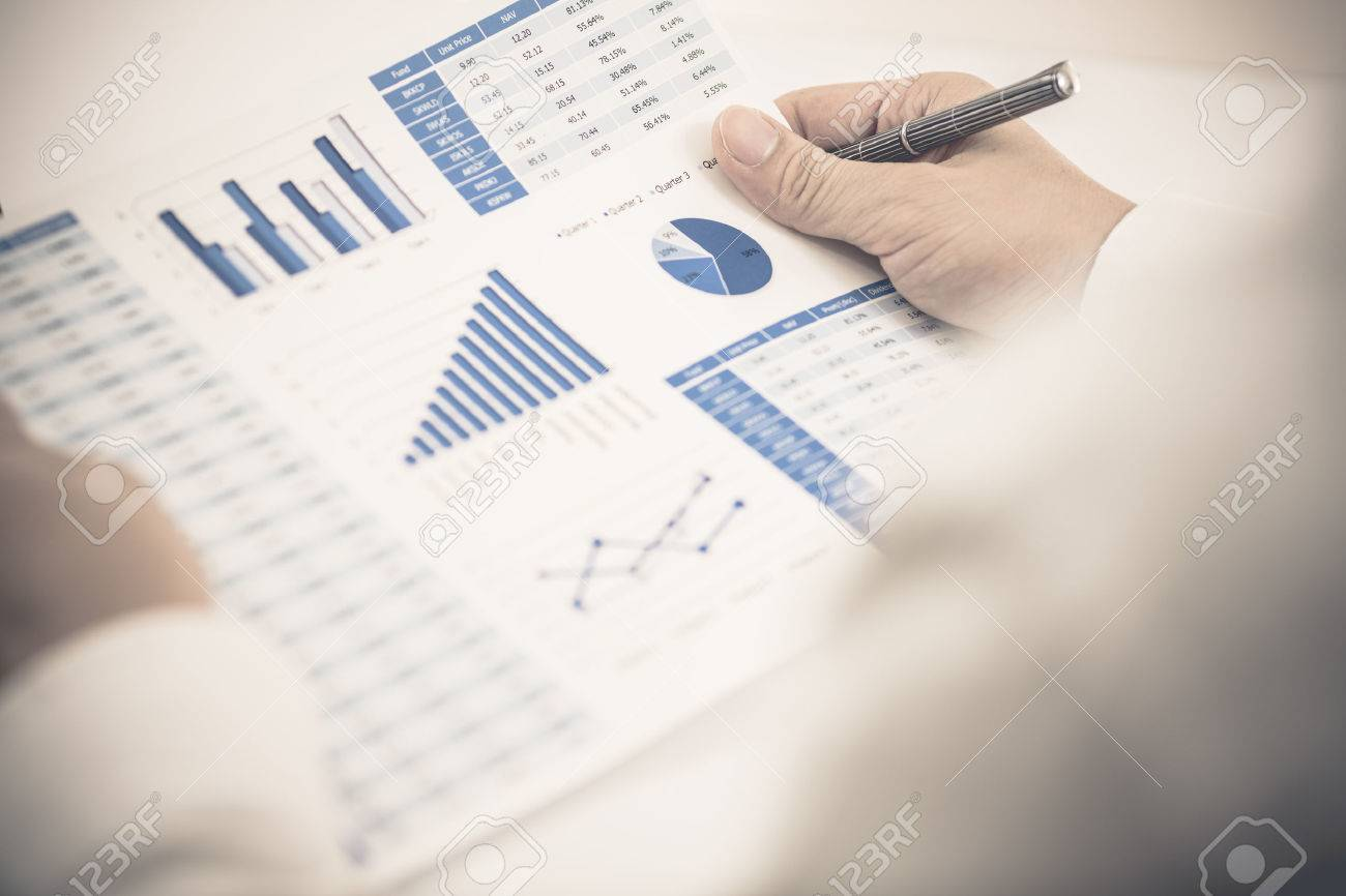 Businessman analyzing investment charts with laptop. Accounting Stock Photo - 31857536