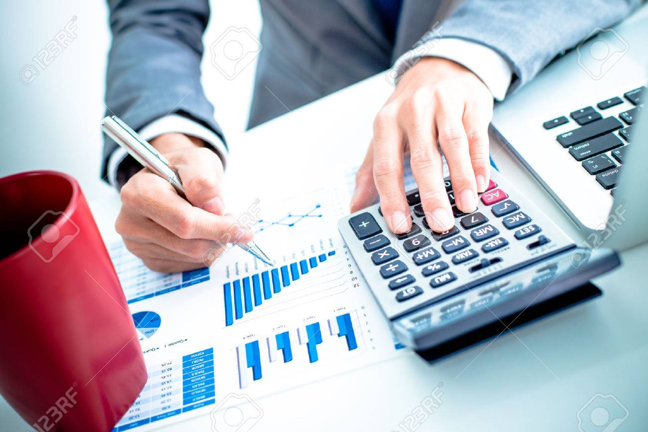 Businessman analyzing investment charts with laptop. Accounting Stock Photo - 36429824