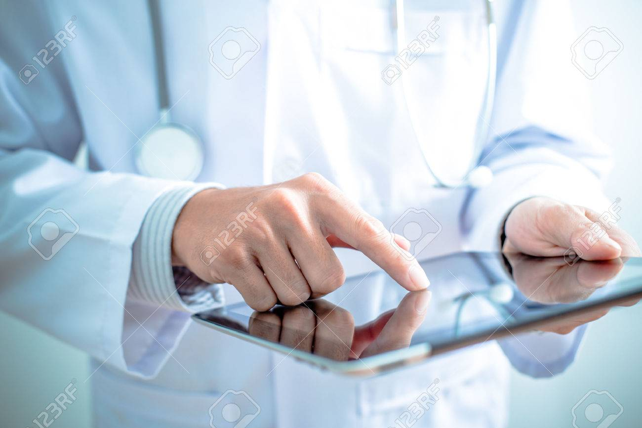 Doctor working on a digital tablet Stock Photo - 36704489