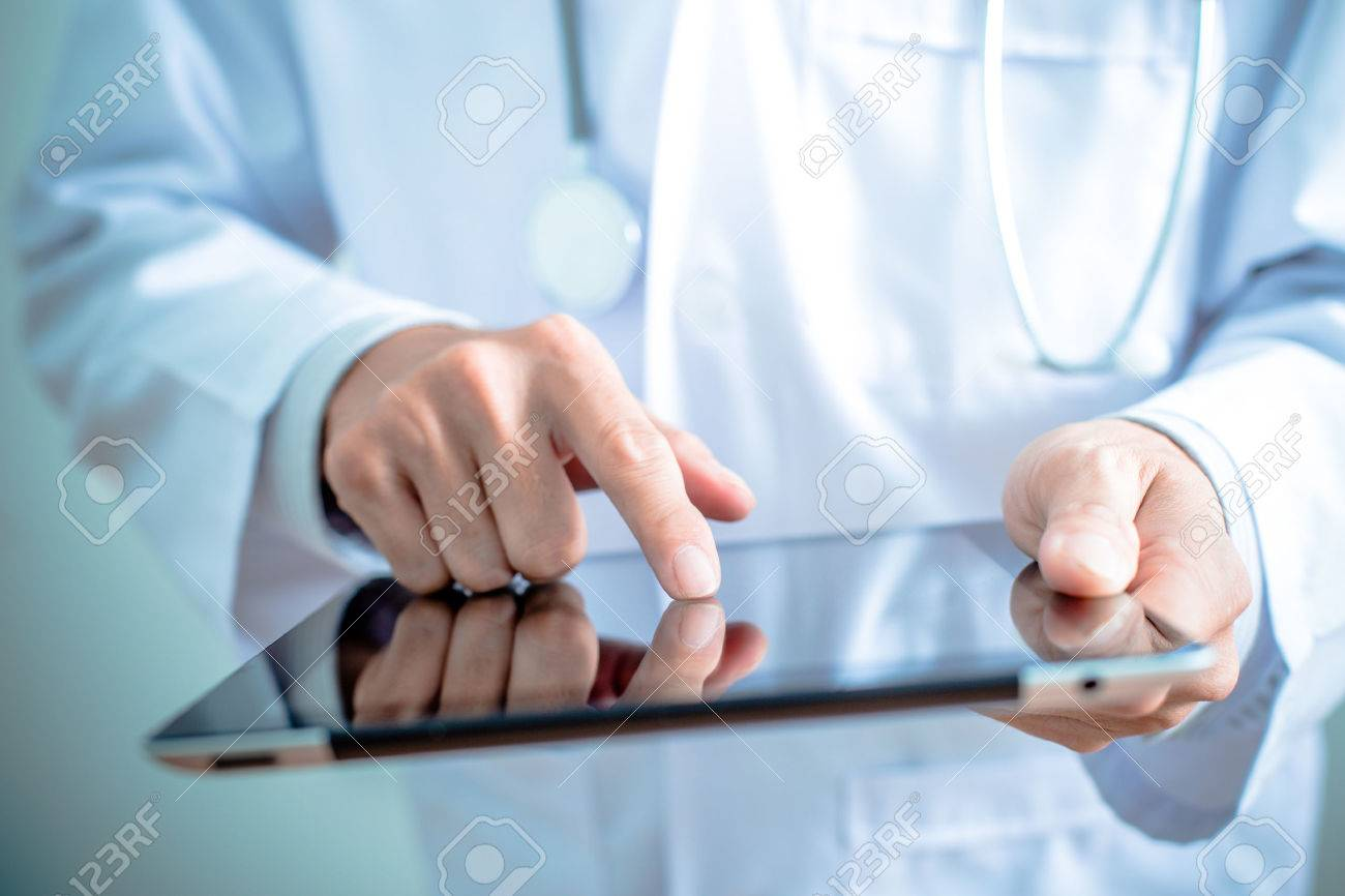 Doctor working on a digital tablet Stock Photo - 36918105