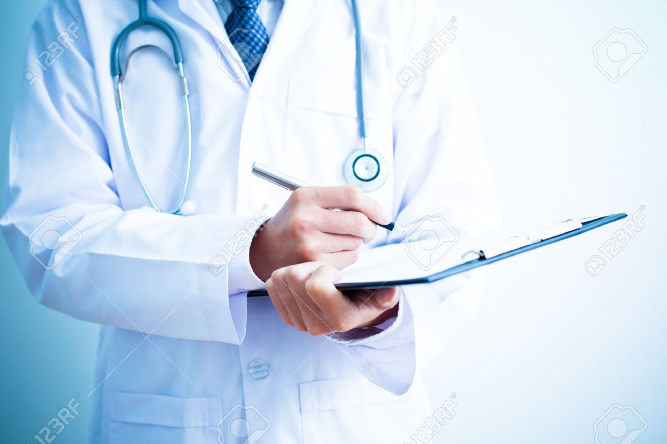 Close-up Of Male Doctor Filling The Medical Form Stock Photo - 37837146