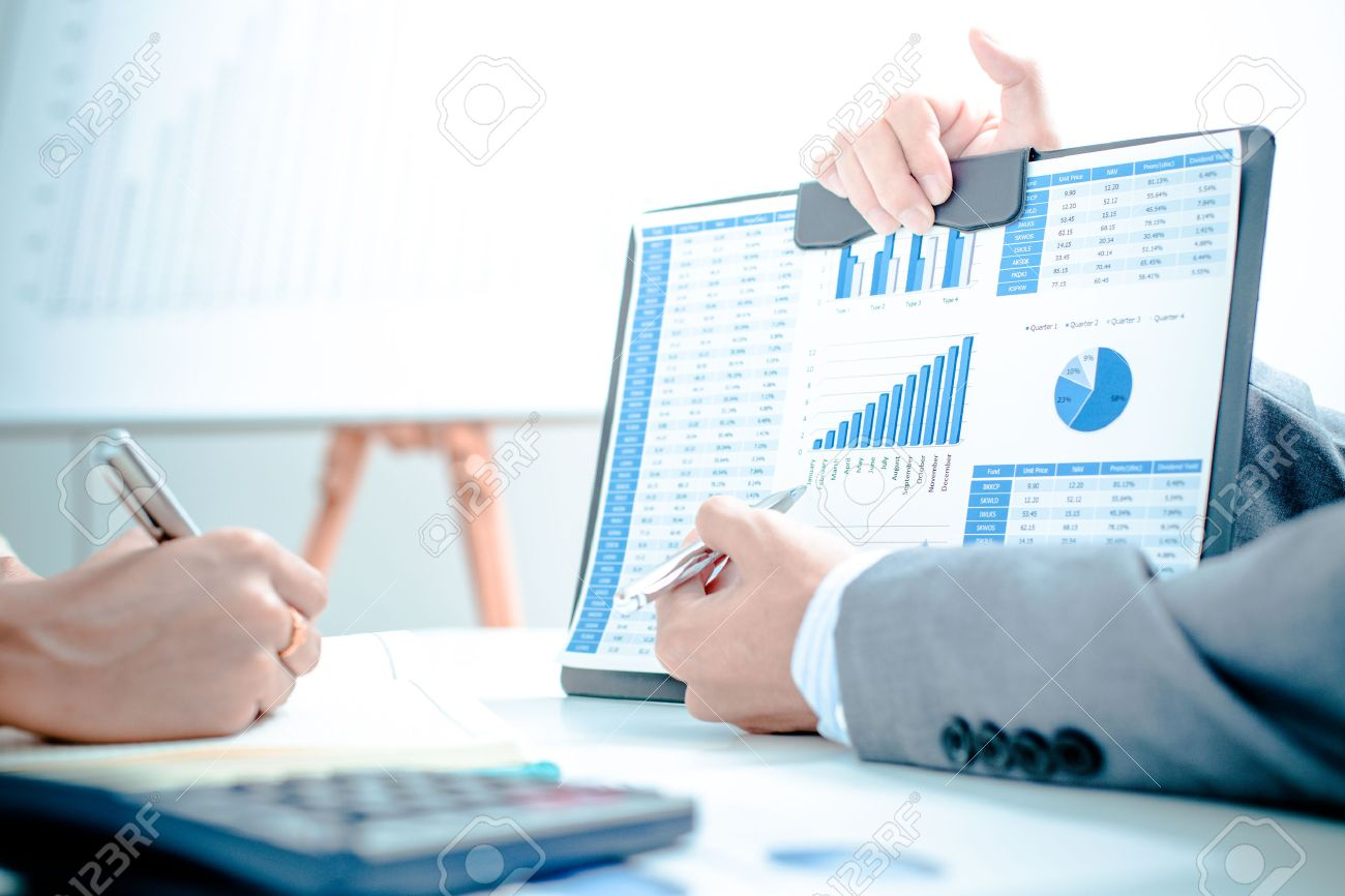 Business people discussing the charts and graphs showing the results of their successful teamwork Stock Photo - 38507538