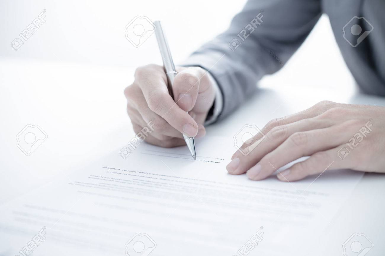 Business man signing a contract - 39839971