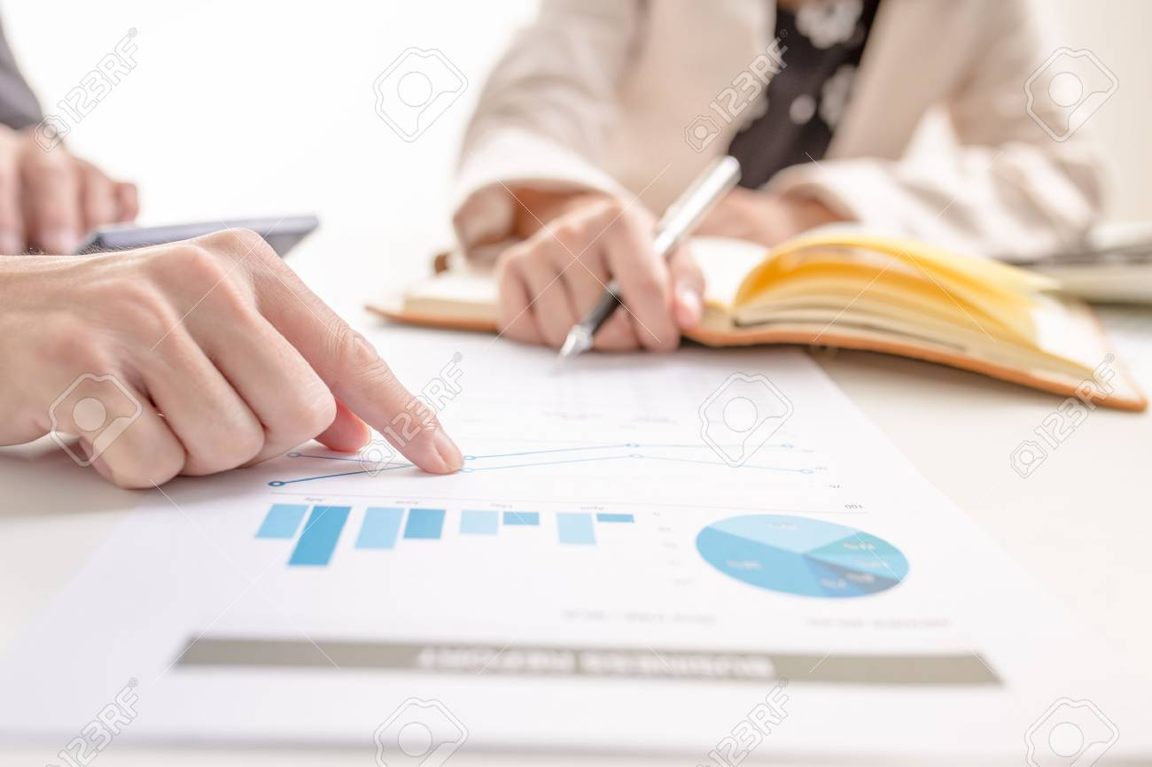 Business people discussing the charts and graphs showing the results of their successful teamwork Stock Photo - 43903383