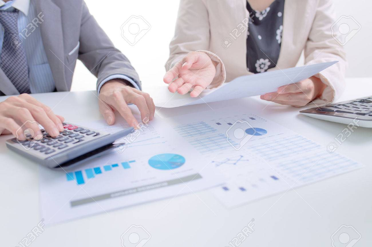 Business people discussing the charts and graphs showing the results of their successful teamwork Stock Photo - 44301554