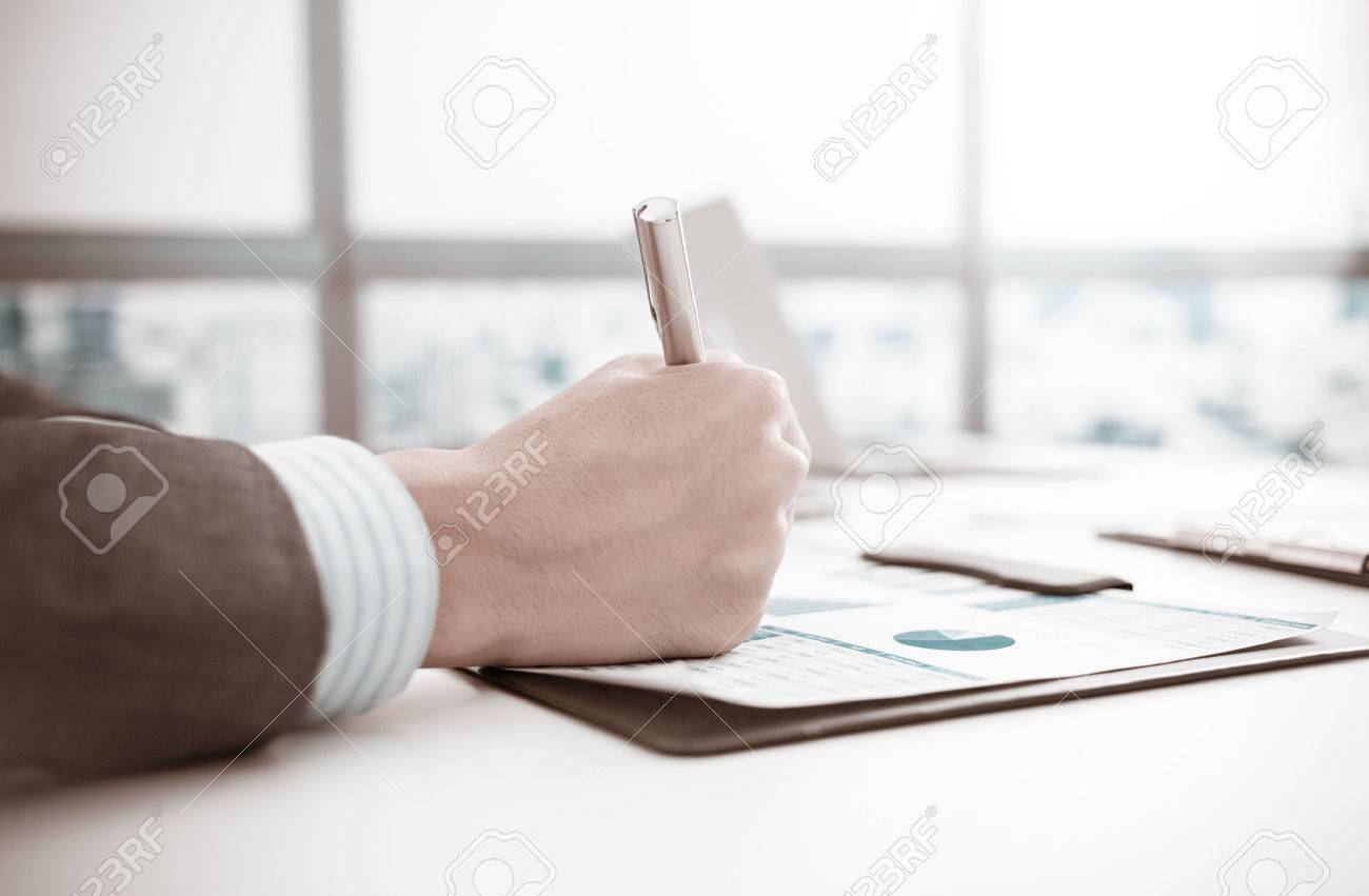 Businessman analyzing investment charts. Accounting Stock Photo - 46206731