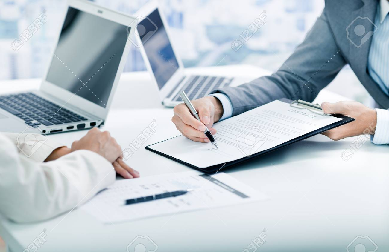 Female hand signing contract. Stock Photo - 46206792