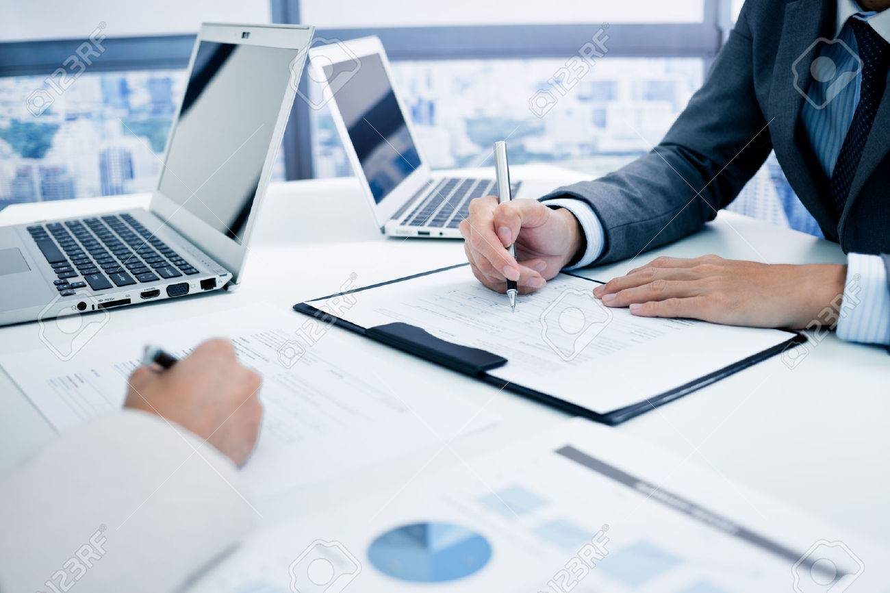Business people discussing the charts and graphs showing the results of their successful teamwork Stock Photo - 46625972