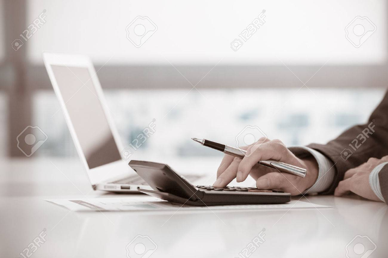 Businessman analyzing investment charts with laptop. Accounting Stock Photo - 47073553