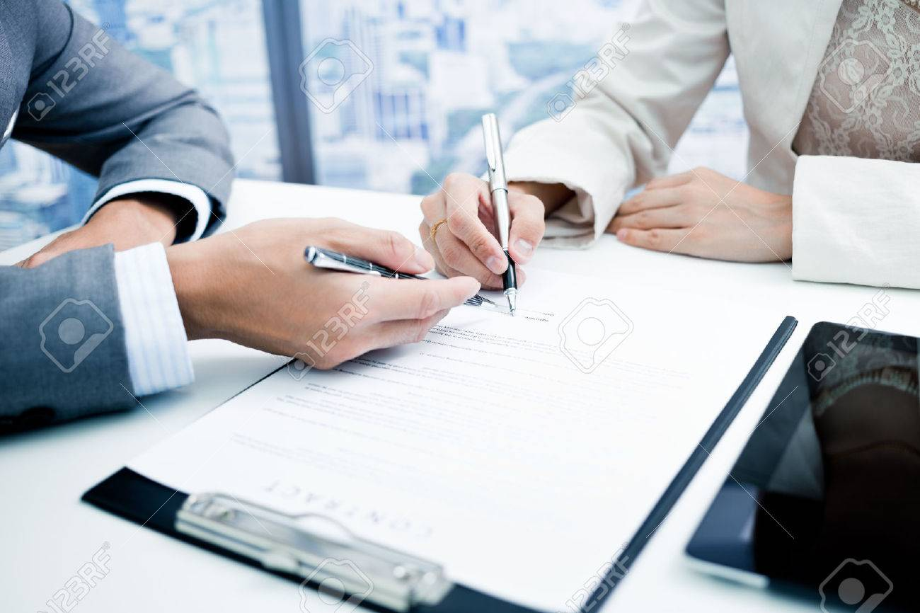 Female hand signing contract. Stock Photo - 50291439