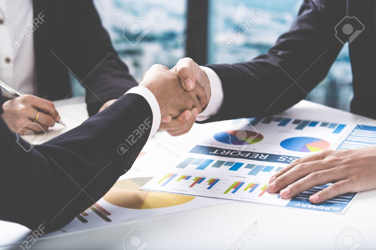 Business handshake and business people Stock Photo - 52348395