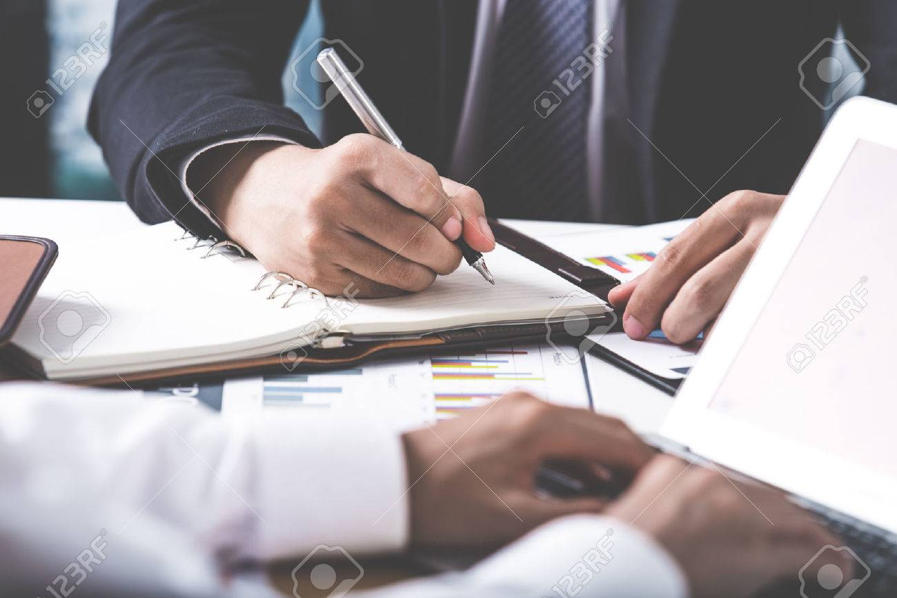 Business adviser analyzing financial figures denoting the progress in the work of the company Stock Photo - 54430624