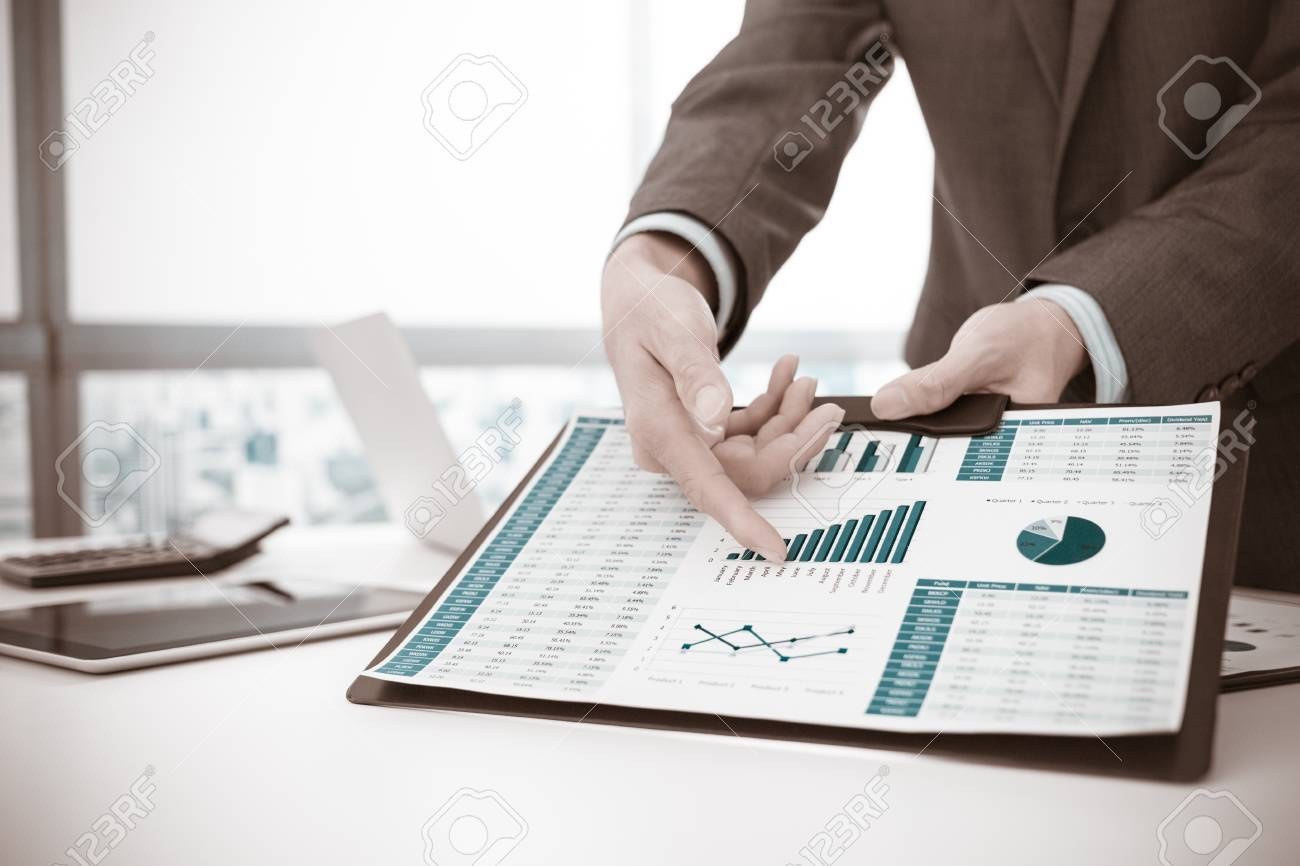 Businessman analyzing investment charts. Accounting - 65805329