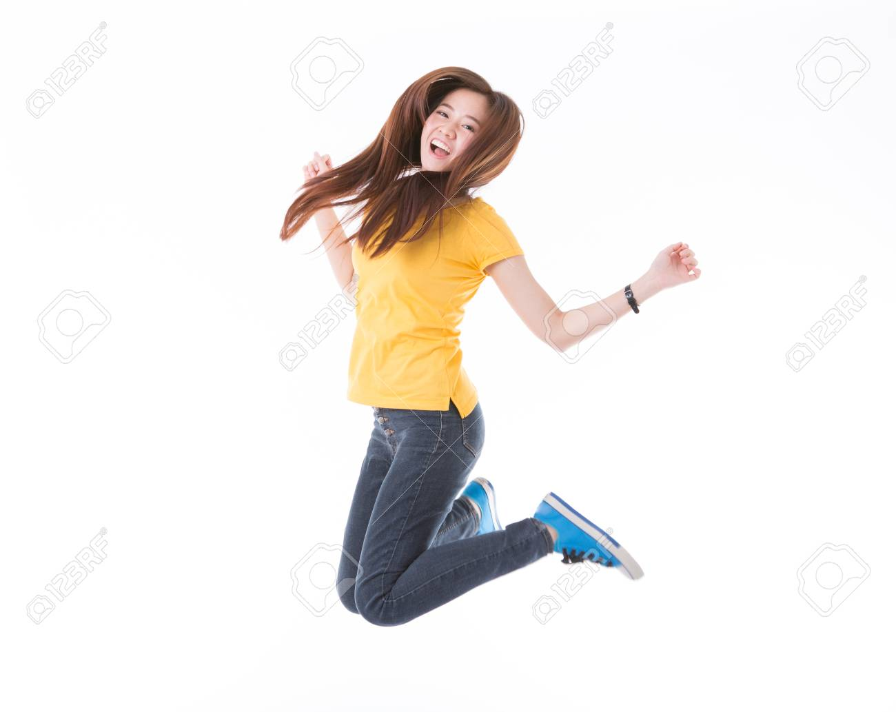 Jumping female college / university student isolated on white background. Young woman Asian Caucasian students. - 65861023