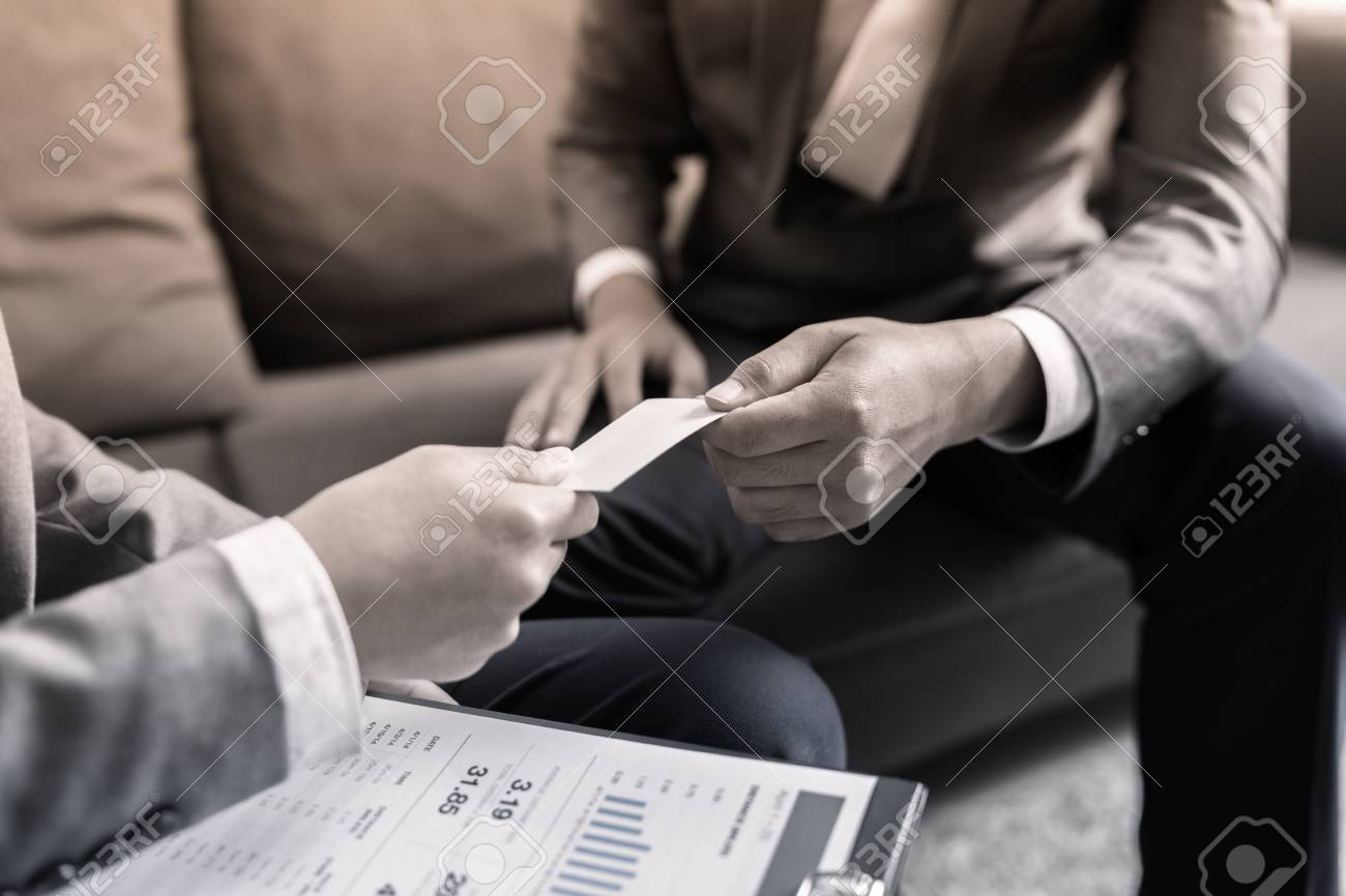 Business executive exchanging business card stock photo picture and business executive exchanging business card stock photo 76758400 colourmoves
