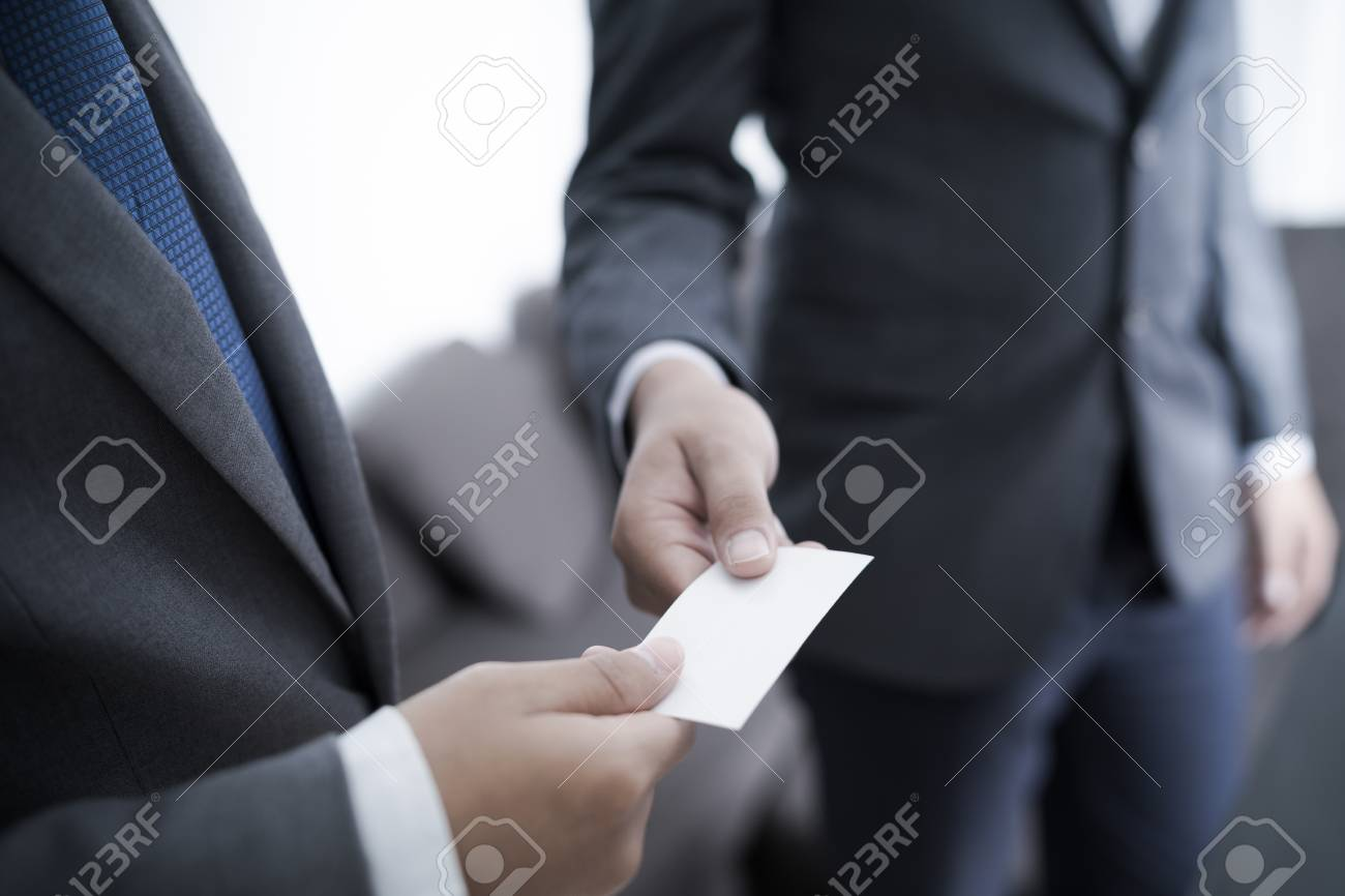 Business executive exchanging business card stock photo picture and business executive exchanging business card stock photo 80123221 colourmoves