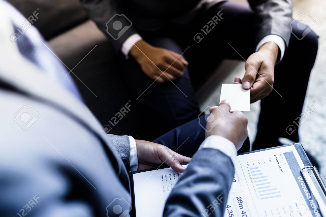 Business executive exchanging business card stock photo picture and business executive exchanging business card stock photo 81876696 colourmoves
